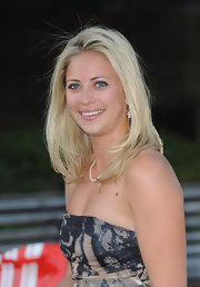 Holly Branson flaunted her luscious locks by wearing them down at the F1 party.
