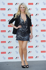 Zoe paired her sparkling cocktail dress with patent, peep toe pumps.
