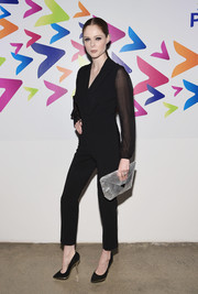 Coco Rocha styled her jumpsuit with a pair of black and gold pumps.