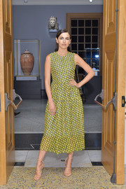 Camilla Belle teamed her cute dress with strappy nude heels by Tamara Mellon.