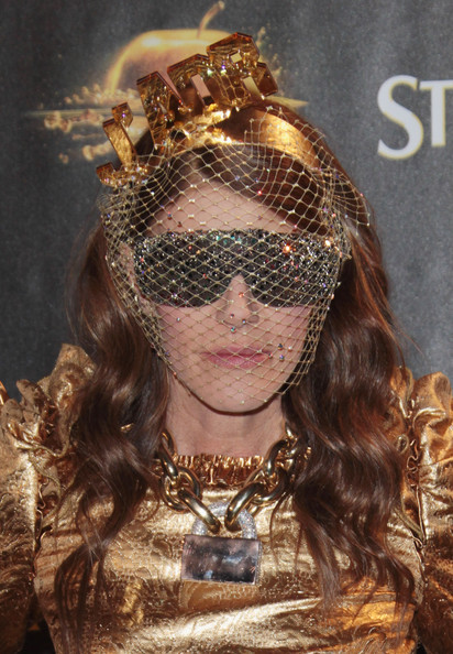 Anna dello Russo teamed her fascinator with a pair of athletic shield sunglasses for a more eccentric finish.