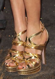 Paola Barale sparkled all the way down to her gold strappy sandals (and glittery toenails).