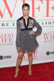 Cush Jumbo paired her dress with nude patent ankle-strap sandals.