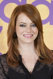 Emma Stone wore a pair of small open pod cluster earrings to 'The Help' photocall in Madrid.