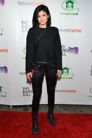 Kylie Jenner went for an ultra-edgy finish with a pair of black leather skinnies.