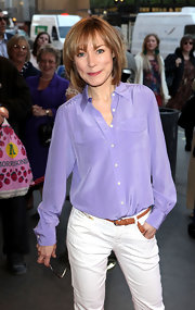 Sian Williams tucked her purple silk button down shirt into a pair of crisp white jeans for a chic look.