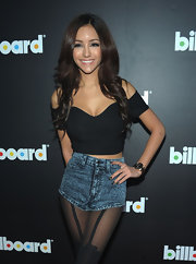 Melanie Iglesias showed some skin in an off-the-shoulder crop top and denim short shorts.