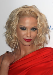 Sarah harding made a bold appearance in a red one-shouldered dress. She topped it off with red lipstick and curly blonde tresses.