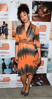 Margot Bingham chose an orange and black tie-dye-style dress with a double-belted waist for her evening look.