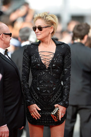 Sharon Stone's gold and black Ferragamo clutch and sexy LBD at the premiere of 'The Search' were a fabulous pairing.