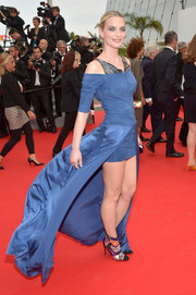 Sarah Marshall flaunted plenty of leg in a dramatic blue fishtail dress during the premiere of 'The Search.'