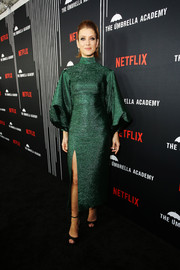 Kate Walsh was diva-glam in an emerald-green Camilla and Marc cocktail dress with balloon sleeves at the premiere of 'The Umbrella Academy.'