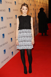 Saoirse paired her two-tone lace cocktail dress with glimmering black pumps.