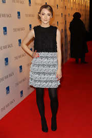 Saoirse looked lovely in a black and white lace tiered cocktail dress.