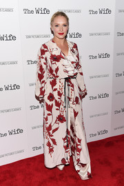 Annie Starke attended the New York screening of 'The Wife' wearing a floral coat and matching pants.