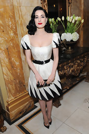 Dita showed off her teensy waist in this black-and-white sqaure neck design at Cafe Royal.