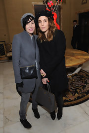 Noomi Rapace looked subdued yet stylish in a black wool coat and boots when she visited the-miumiu-london.