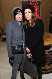 Noomi Rapace accessorized her all-black outfit with an angular gray leather tote when she visited the-miumiu-london.