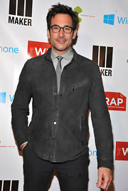 Lawrence Zarian opted for a gray snap-button fitted jacket for a cool and modern feel at The Wrap pre-Oscar party.