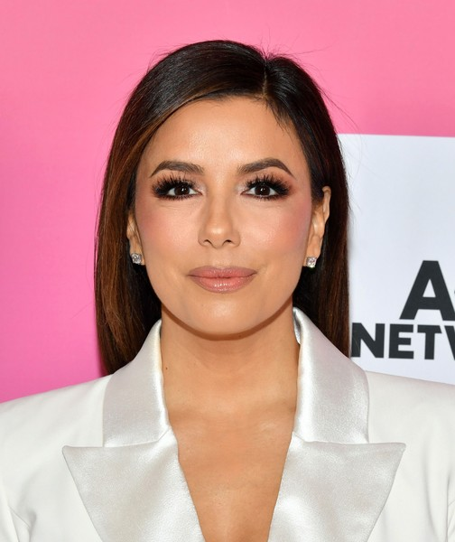 Eva Longoria accessorized with a pair of classic diamond studs.