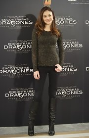 Olga Kurylenko accented her casual premiere attire with slouchy black leather knee high boots.