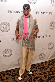 Dennis Rodman is not stranger to over-the-top clothes like these gold silk pants and sequined top.
