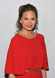 Chrissy Teigen swept on a rich red lipstick for a screening of 'Think Like a Man.'