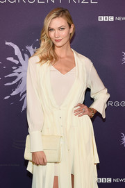 Karlie Kloss paired an ivory croc-embossed clutch with a matching shirtdress for the Berggruen Prize Gala.