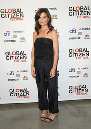 Katie Holmes teamed a pair of studded sandals with a strapless jumpsuit for the 2014 Global Citizen Festival.