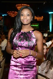 Coco Jones showed off her shiny ebony hair with slight waves at the Inside the Thirst Gala.