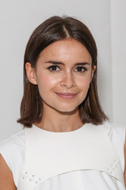 Miroslava Duma wore a casual straight center-parted 'do at the Thom Browne fashion show.
