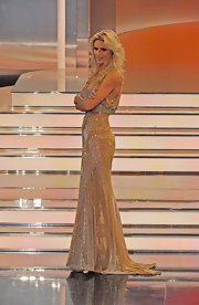 Michelle shined on stage of 'Wetten Dass...?' in a semi-sheer gold gown.