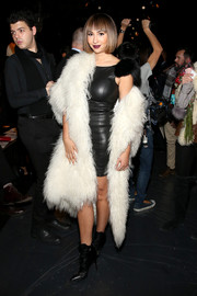 Jackie Cruz was rocker-glam in a shaggy white coat layered over a leather LBD at the Thomas Wylde fashion show.