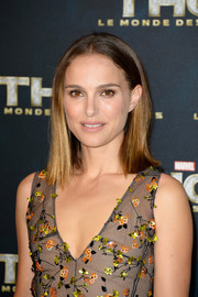 Natalie Portman opted for simple styling with this straight center-parted 'do at the premiere of 'Thor: The Dark World' in Paris.