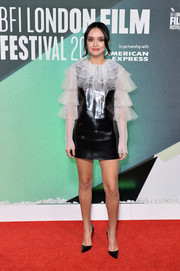 Olivia Cooke completed her look with pointy black pumps.