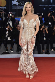 Soo Joo Park coordinated her dress with a pair of champagne T-strap sandals by Christian Louboutin.