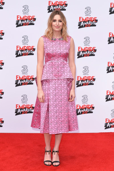 A pair of charm-embellished strappy sandals finished off Laura Carmichael's look.