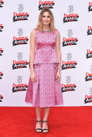 Laura Carmichael kept it sweet in an embroidered pink peplum dress by Erdem at the Three Empire Awards.