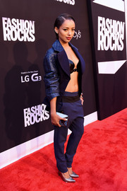 Kat Graham tempered her super-skimpy bra top with a blue jacket during Fashion Rocks 2014.