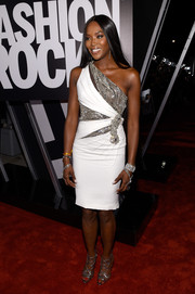 Naomi Campbell kept the shimmer going with a pair of silver strappy sandals by Alexandre Birman.