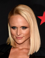 Miranda Lambert topped off her look with a cool, sleek asymmetrical bob when she attended Fashion Rocks 2014.