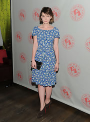 Carey Mulligan carried a petite black clutch with gold piping at the after party for 'Through a Glass Darkly.'