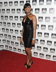 Fantasia Barrino teamed her leather dress with a pair of bowed patent peep-toes.