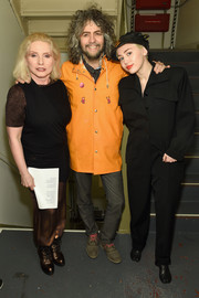Miley Cyrus teamed her jumpsuit with black split-toe boots by Maison Margiela.