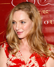 Uma Thurman rocked a mussed-up wavy 'do at the Tibet House benefit auction.