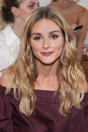 Olivia Palermo sat front row at the Tibi fashion show sporting her signature center-parted waves.
