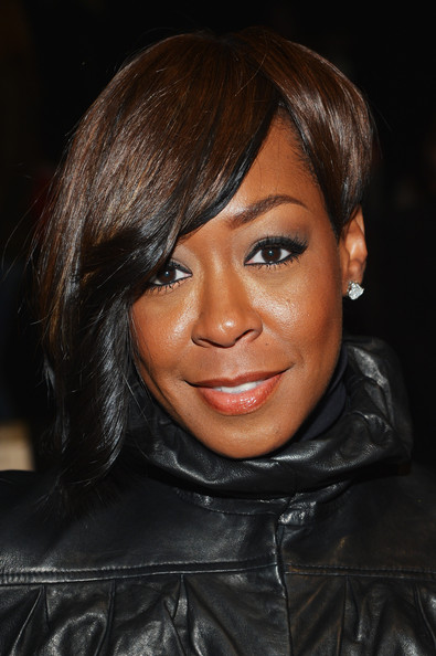Tichina Arnold Short Side Part [project runway,hair,face,eyebrow,hairstyle,lip,black hair,chin,cheek,forehead,bangs,tichina arnold,front row,lincoln center,new york city,the theatre,mercedes-benz fashion week,fashion show]