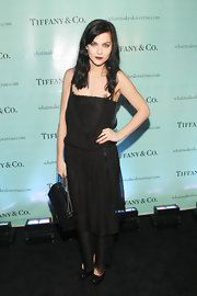 Leigh Lezark accented her darkly romantic style with a black quilted Chanel purse.