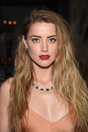Amber Heard polished off her look with a gorgeous tourmaline and diamond collar necklace by Tiffany & Co.