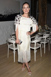 Olivia Wilde chose simple white Stuart Weitzman Nudist sandals to complement her dress.